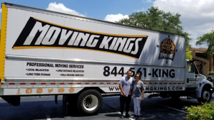Moving Kings crew at work with a satisfied customer - explore the diverse moving services Florida we offer.