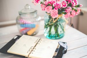 moving planner and flowers on the table
