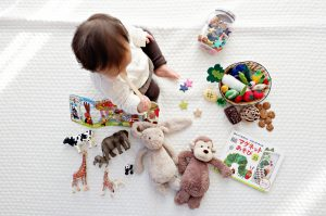 A child playing with many toys