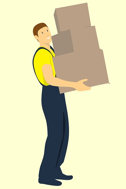 a reliable moving company man carrying boxes for someone moving to Lake Worth