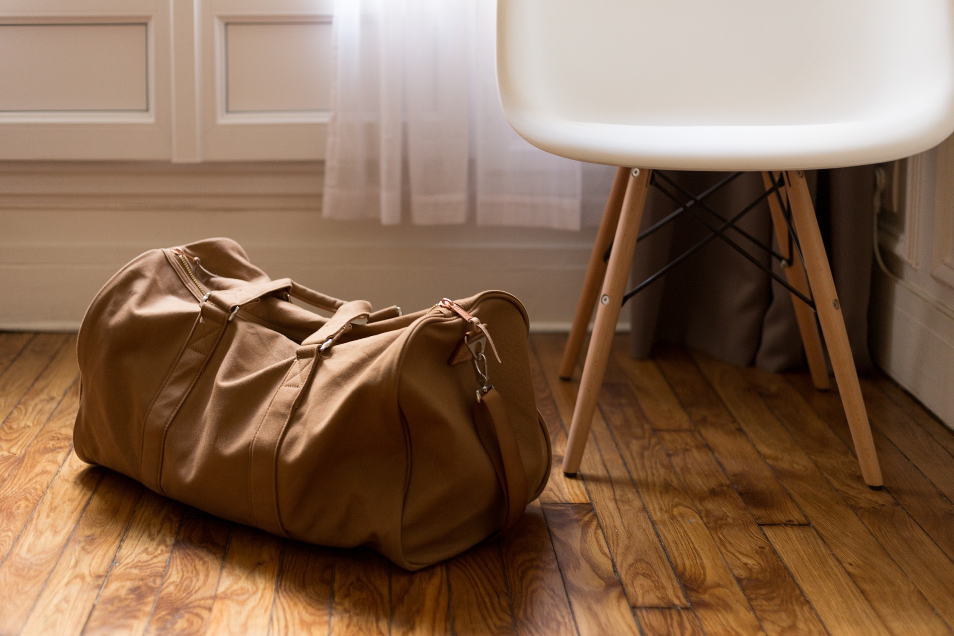 Image of a suitcase that contains what you should wear on moving day.