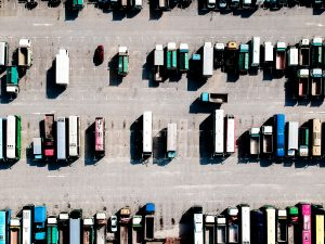 An aerial view of a parking lot with trucks and vans.