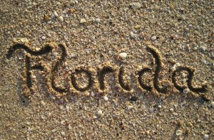'Florida' written out in wet sand.