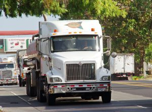 A white truck on the road representing movers Homestead FL.