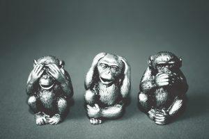 sculptures of three wise monkeys