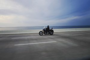 A man driving a motorcycle down a highway.
