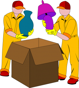 two men packing boxes with lamp and vase