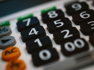 A zoomed in picture of a calculator keyboard, used for buying a house in Pembroke Pines