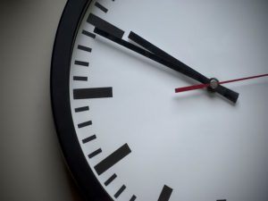A zoomed in picture of a black and white clock.