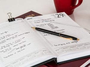 A notebook with a schedule.