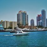 A view of the Miami skyline from the river during the day.