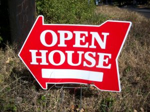 A red sign with white 'Open house' letters.