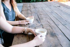 Two people enjoying coffee.