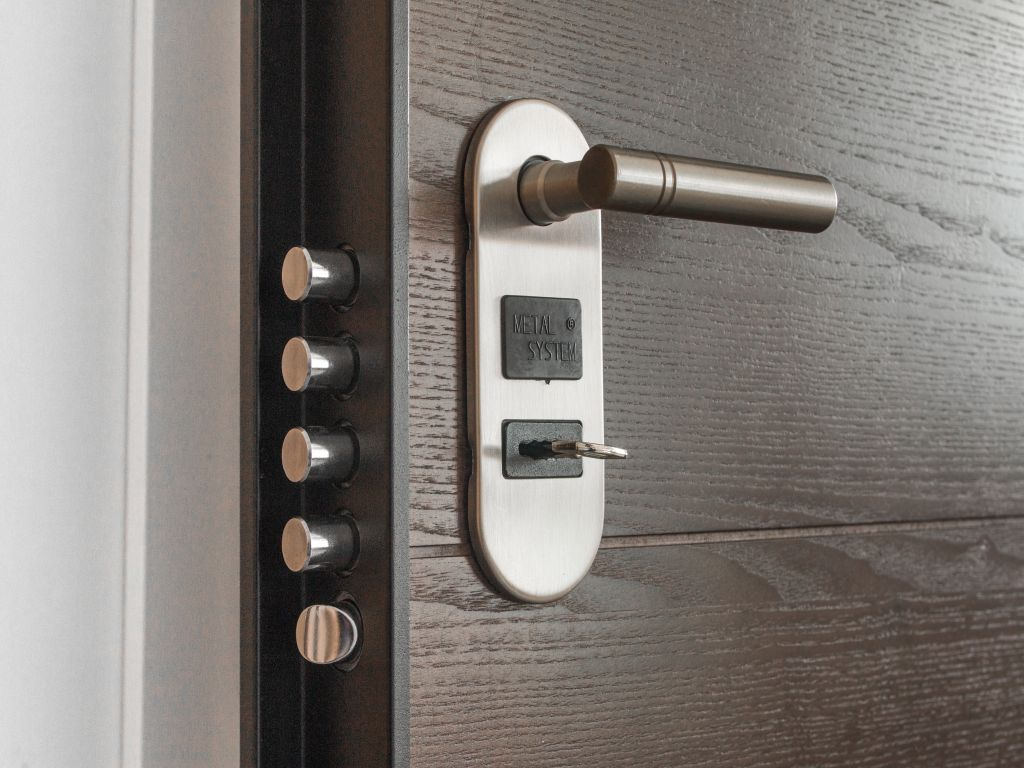 A modern door with multiple locks, as per home safety tips.