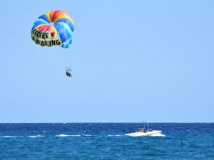 A person parasailing above the ocean.
