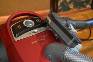 A zoom-in picture of a red vacuum.