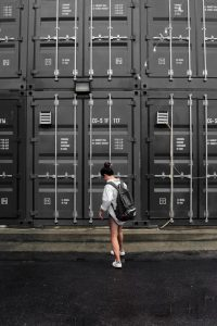 A girl in-front of a reliable cheap storage.