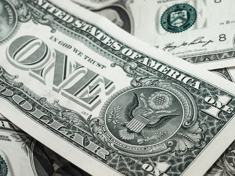 A close-up of a dollar bill.
