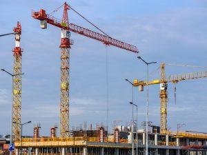 Cranes above a construction site.
