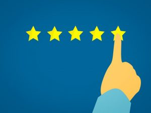 A digital image of a person choosing a five star rating.