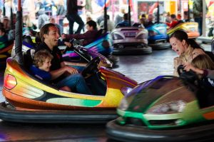 People enjoying themselves in bumper cars.