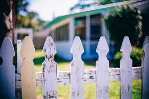 A close up of a white picket fence.
