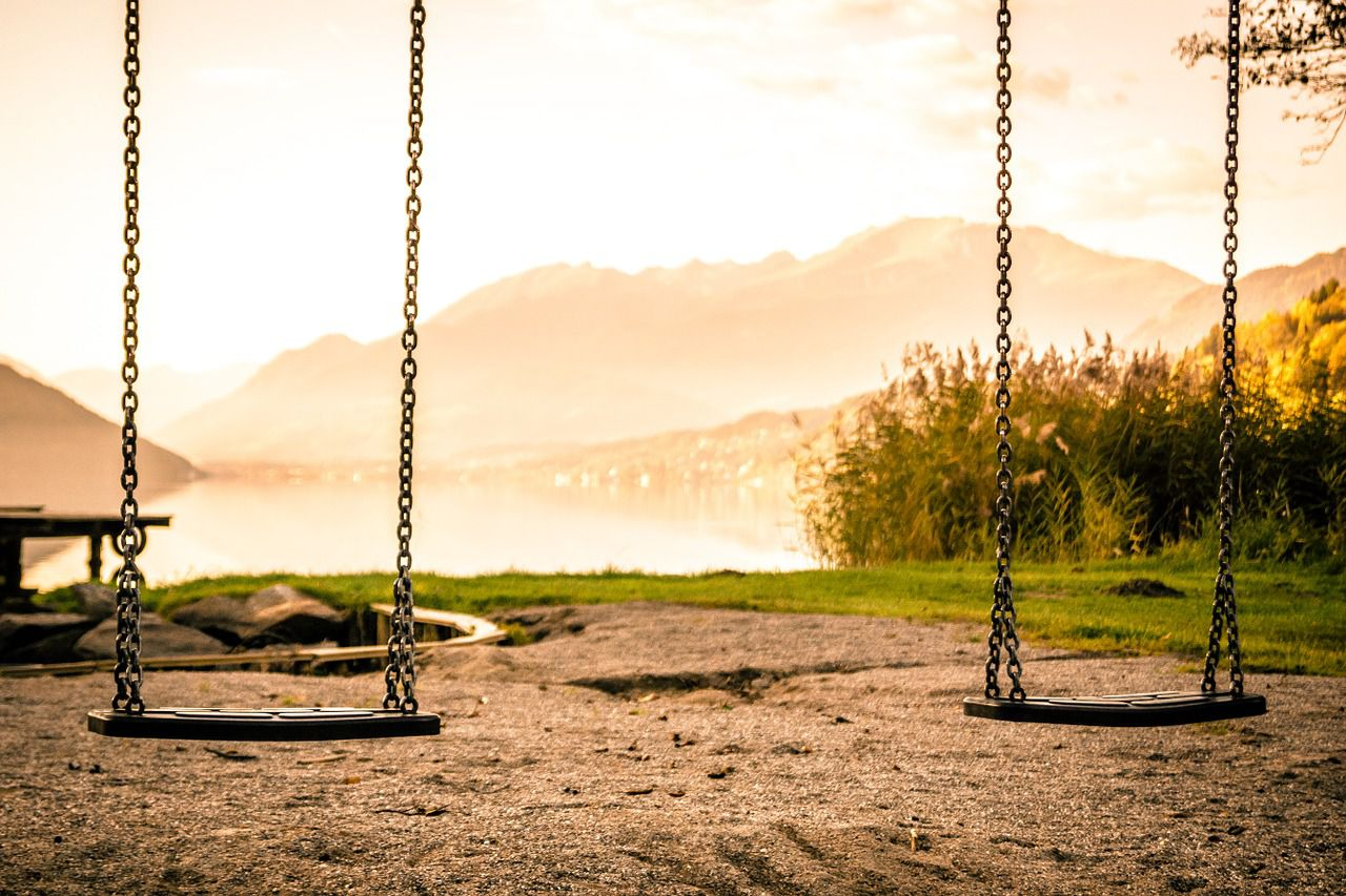 Two empty swings in one of the most popular playgrounds for kids in Miami.