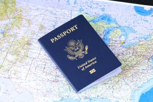A passport on a map that should be packed to prepare for a military move.