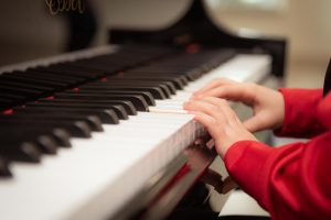 A child playing a piano.