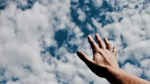 The sky and a man's hand.
