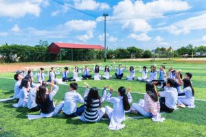 Kids sitting in a circle