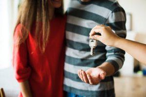 A couple receiving keys.