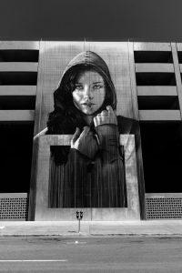 a woman's portrait on a wall