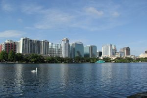 lake eola in Orlando with the buildings in the background