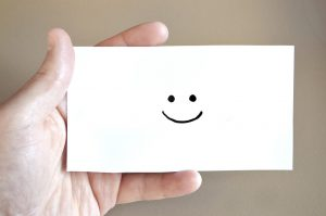 A smiley face on a piece of paper.