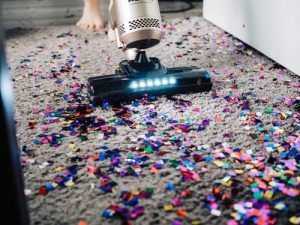 Before you pack and move large area rugs, vacuum them