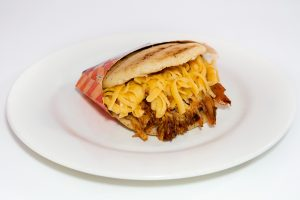 Arepas are like a pancakes, just stuffed with meat and cheese.