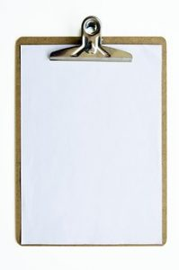 a clipboard with paper