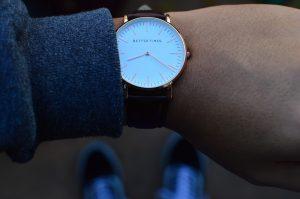 A watch on a wrist.