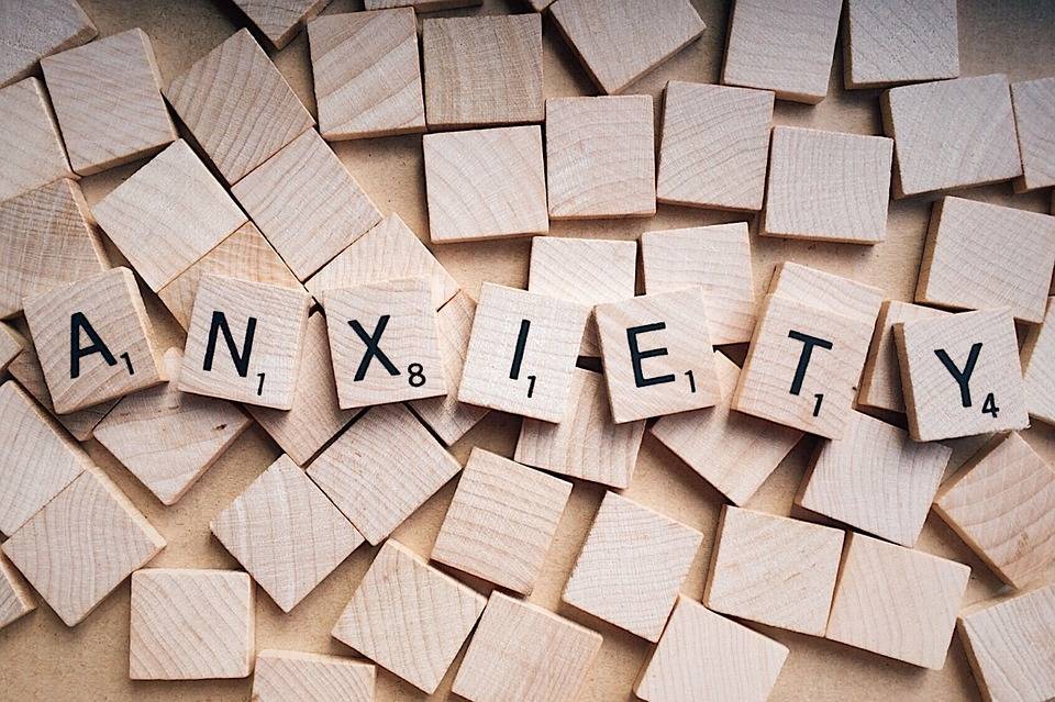 Wooden cubes spelling out anxiety.