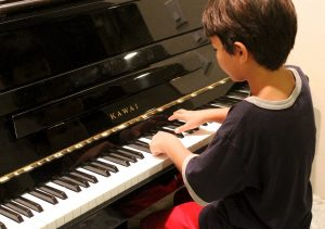 A boy playing the piano.