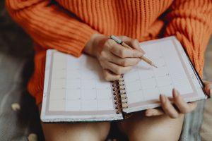 a girl with a calendar