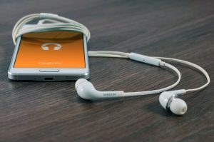 Phone with earplugs