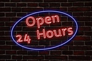 A sign that says open 24 hours