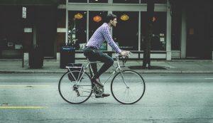 a man riding a bike on the street