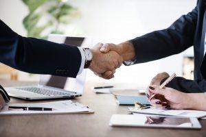 a handshake over a desk
