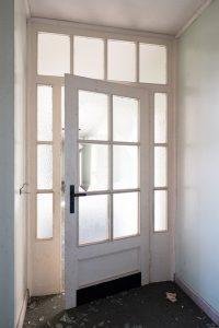 a broken window on an entrance door of a house