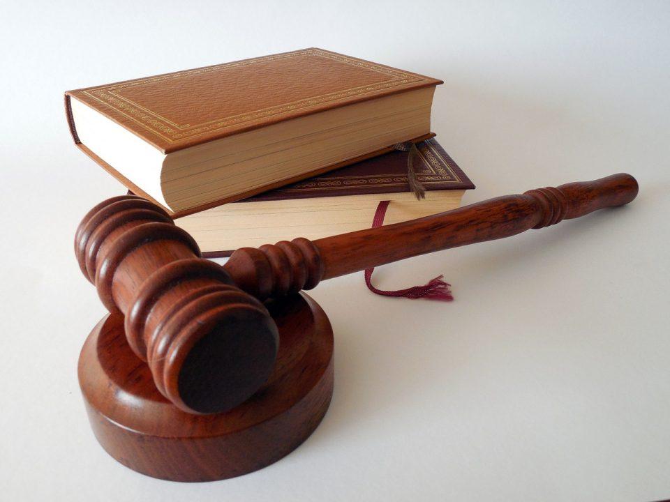 a book and a hammer representing a judge