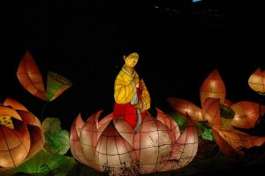 a woman sitting in a lotus, Chinese sculpures, LED-lit