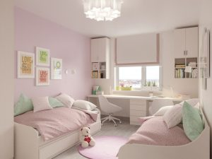 girls` room with pink sheets on their beds
